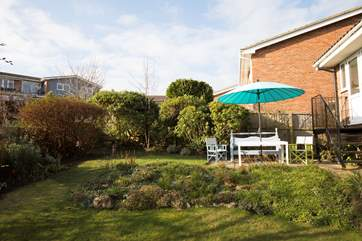 Take a drink outside and enjoy the Island's sunshine all year around. There are also outdoor sofas at the bottom of the garden!