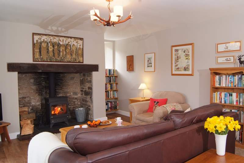 The gorgeous sitting-room has a wood-burning stove at its heart and has been furnished with extra touches to make this a real home from home property.