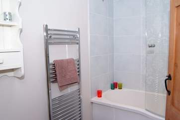 The bathroom is on the first landing, there is a fitted shower as well as the deep bath.