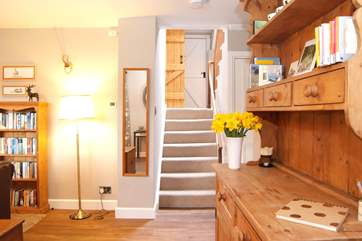 Stairs lead from the sitting-room to the kitchen/dining-room and the bathroom.