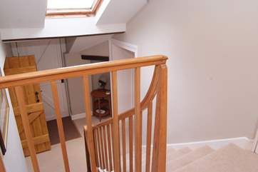 The second flight of stairs takes you up to the two double bedrooms.