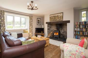 There is a wonderful living room with a wood burning stove at its heart and a special farmhouse feel.