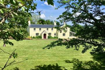 Stockham Farm is a stunning traditional Exmoor farmhouse. The fully independent self-catering wing is to the left, with the porch.