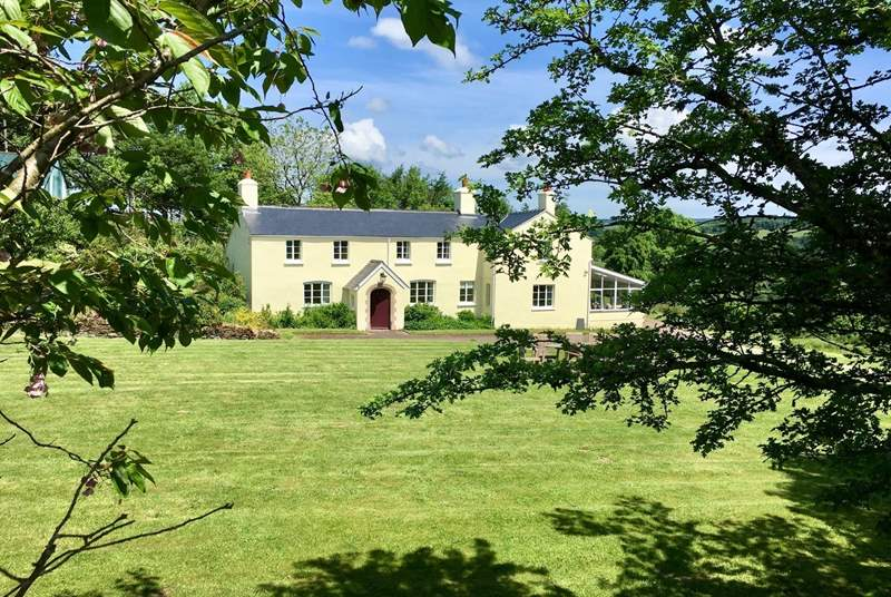 Stockham Farm is a stunning traditional Exmoor farmhouse. Guests have the Victorian annexe - to the left of, and above the porch - all to themselves as well as a side garden and the lawns in front of