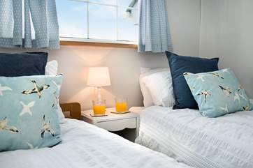 Lovely crisp white linen and plump cushions adorn the beds.