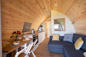 Deceptively spacious inside with a double bed at the rear, the en suite shower-room, kitchen-area, dining-area and sitting-area (where the sofa easily converts into a huge double bed).