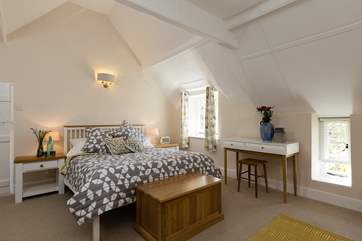 This is the double bedroom in the cottage part of Champarty. It is a wonderfully 'Scandinavian' feeling room with high ceilings and a bright style.