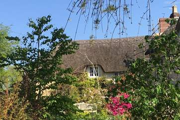 This is the attached cottage - reserved solely for groups of 14 and never booked separately. It has its own courtyard garden and links to the main house on the first floor.