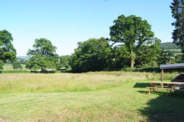 This is the fabulous meadow  complete with pizza oven and picnic bench. What a place to enjoy.