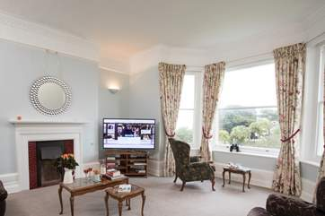 The sitting-room is a light and spacious room with views through the bay window, high ceilings and original features.