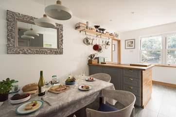 A convivial cooking and dining area.