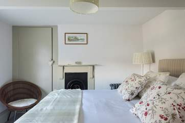 Lots of original features in the cottage, such as this lovely Victorian fire surround.