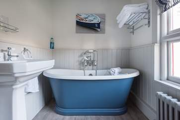 The family bathroom has a pretty free-standing, roll-top bath.