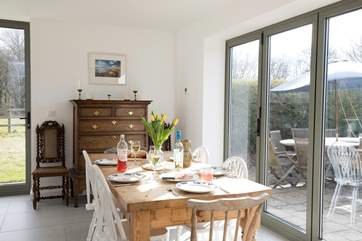 The stunning dining-area has a large table seating six with doors out to the patio and garden which you can open up on those sunny days.