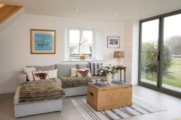 The living/dining area is an extension to the original cottage, with modern under-floor heating.