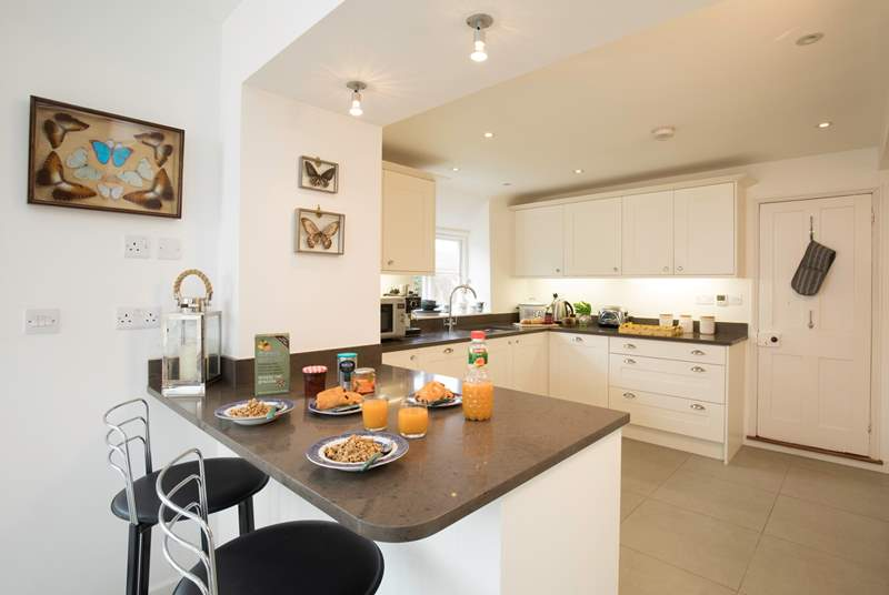 The impressive kitchen/dining area is a fabulous place for entertaining and cooking.