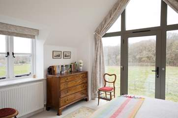 The master bedroom is surrounded with gorgeous countryside views, a beautiful setting to wake up to.