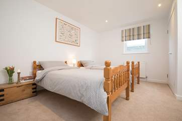This lovely twin bedroom is very warm and cosy.