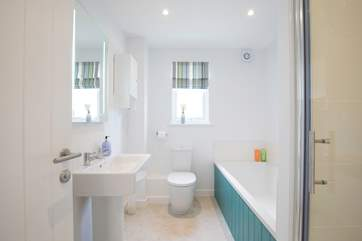 Family bathroom with bath and separate shower cubicle.