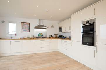 This beautiful modern and well-equipped kitchen is ideal for cooking up a family feast.