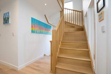 The beautifully built staircase is a focal point in the property.