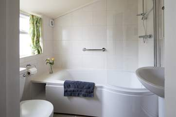 The ground floor bathroom has a fitted shower and heated towel rail.