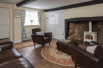 The cosy sitting-room has the original inglenook fireplace with a wood-burner effect gas stove, the thatch does not allow for an open fire.