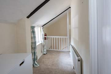 Pitched ceilings on the first floor add to the charm of this delightful cottage.
