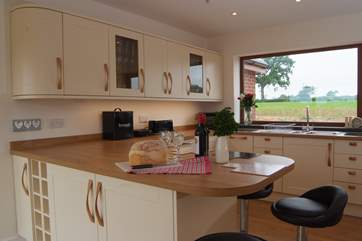 Lakeview House has an amazing spacious contemporary kitchen with a breakfast bar.