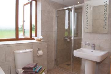 The first floor family bathroom has a large walk in shower as well as a bath.