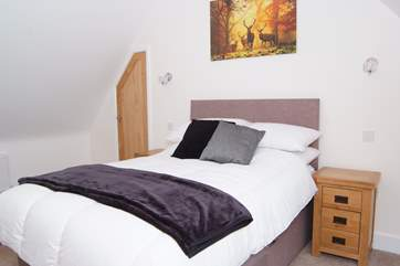 This double bedroom is on the second floor. There is a very convenient 'cloakroom' on the second floor too.