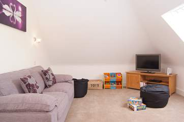 Last but not least - on the second floor - there is even this wonderful play room equipped with TV, games and toys for children.