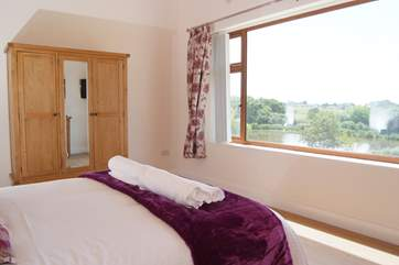 The master bedroom has a stunning panoramic view over the lakes and the countryside beyond.
