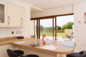 The lovely bright kitchen has a sliding door to the patio