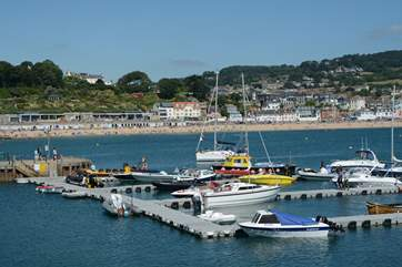 Lyme Regis is a fabulous place to visit, independent shops, town museum, fossils, and lots of places to watch the world go by.