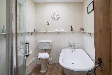 The luxurious bathroom is on the ground floor with roll-top bath and separate shower cubicle.
