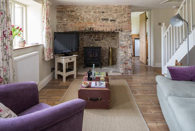 The sitting-room has a fabulous inglenook fireplace, with wood-burner effect electric stove, the thatch does not permit an open fire.