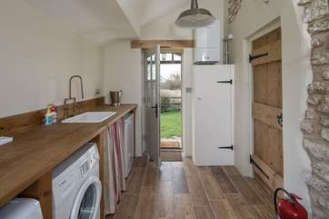The spacious boot/utility-room leads in from the rear garden of the cottage.