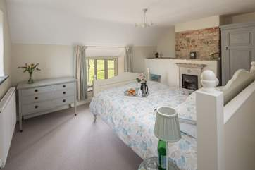 Fabulous views over open countryside from the window of the galleried bedroom.