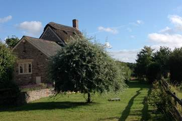 The very private south-facing garden is behind the cottage, surrounded by farmland and a network of footpaths and bridleways.