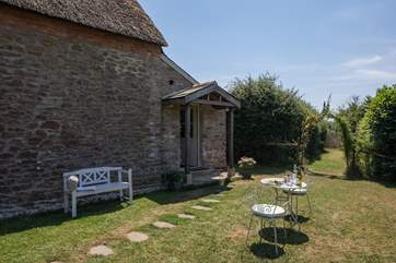The tranquil and private garden is behind the cottage and the entrance to the boot/utility-room.