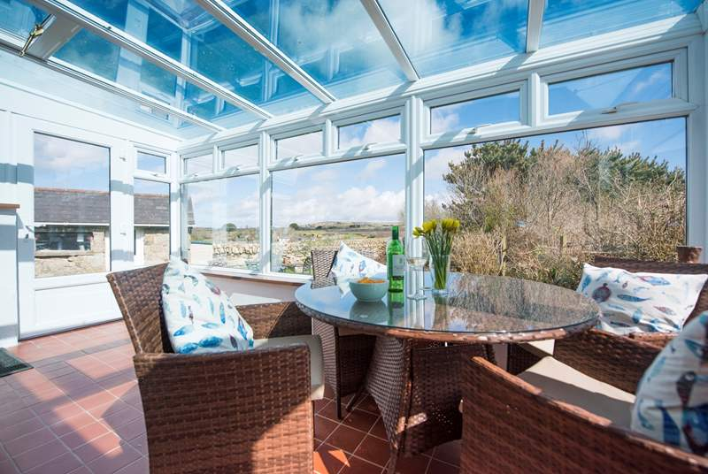 Enjoy the views from the sun-room.