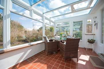 The sunny sun-room looks out over the garden.