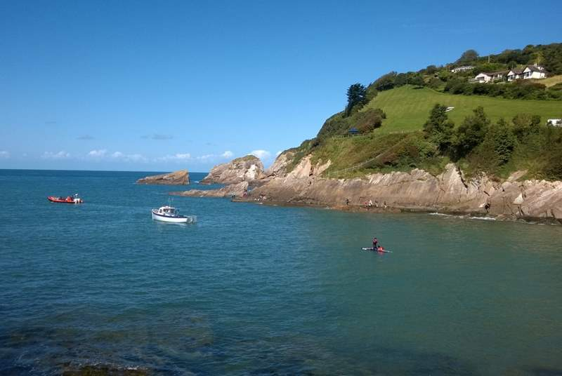 This is Combe Martin, with a lovely sandy bay - and in the distance the cliffs are where Exmoor meets the sea.