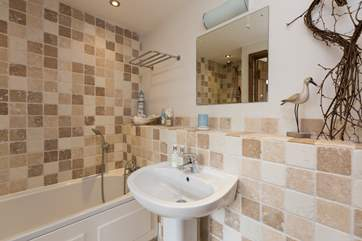 As well as en suite facilities upstairs there is a ground floor bathroom too.