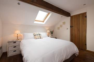 This is one of the two double bedrooms. This bedroom has an en suite WC and wash-basin.