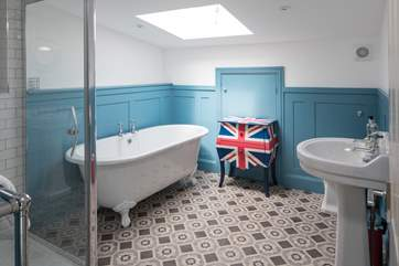 The en suite to bedroom 5 (the family room) has a bath and a shower cubicle. Perfect to wash away the day's sand and suncream.