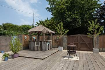 This fabulous little hut provides the perfect spot for your barbecue food and drink.