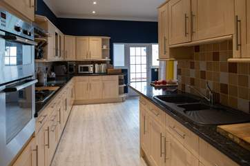 From the entrance porch/boot room, you step into this lovely kitchen.
