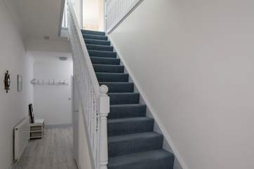 The hallway stairs lead up to the first floor bedrooms and bathrooms.
